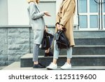 two teen girls in a street.... | Shutterstock . vector #1125119600