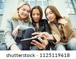 school girls using tablet... | Shutterstock . vector #1125119618