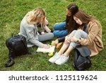 meeting girlfriends in a park.... | Shutterstock . vector #1125119624
