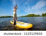 joyful man is training  sup... | Shutterstock . vector #1125129833