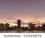 town in tokyo at dusk tokyo is... | Shutterstock . vector #1125143276
