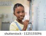 african student girl doing math ... | Shutterstock . vector #1125155096
