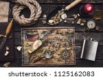 old treasure map on adventurer... | Shutterstock . vector #1125162083
