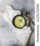 green peas cream puree soup in...   Shutterstock . vector #1125170300