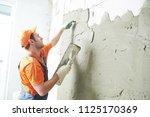 renovation at home. plasterer... | Shutterstock . vector #1125170369