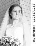 wedding attractive bride with... | Shutterstock . vector #1125171266