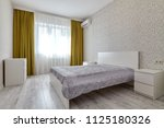 bedroom with a beautiful... | Shutterstock . vector #1125180326