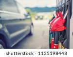 close up fuel nozzles on petrol ... | Shutterstock . vector #1125198443