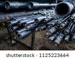 oil drill pipe. rusty drill... | Shutterstock . vector #1125223664