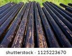 oil drill pipe. rusty drill... | Shutterstock . vector #1125223670
