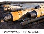 oil drill pipe. rusty drill... | Shutterstock . vector #1125223688