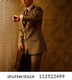 retro businessman looking at... | Shutterstock . vector #112522499