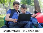 the father trains the son to... | Shutterstock . vector #1125235100