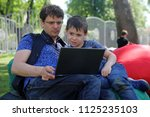 the father trains the son to...   Shutterstock . vector #1125235103