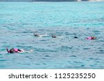 group of skin diver on the sea... | Shutterstock . vector #1125235250