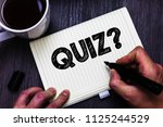 text sign showing quiz question.... | Shutterstock . vector #1125244529
