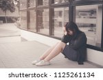 asian woman sitting alone and... | Shutterstock . vector #1125261134