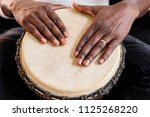 Musician Playing Drum With His...