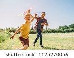 happy kid is running on field.... | Shutterstock . vector #1125270056