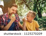 portrait of father and son... | Shutterstock . vector #1125270209