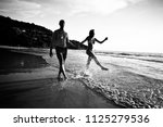 silhouettes of athletes running ... | Shutterstock . vector #1125279536