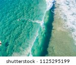 An Aerial View Of A Surfer...