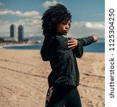 young happy black woman doing... | Shutterstock . vector #1125304250