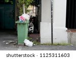 excessive rubbish on the green... | Shutterstock . vector #1125311603