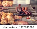 grilled meat  sausages skewers... | Shutterstock . vector #1125315206