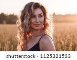 young beautiful girl in light...   Shutterstock . vector #1125321533