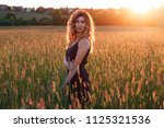 young beautiful girl in a black ...   Shutterstock . vector #1125321536