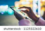 girl pointing finger on screen... | Shutterstock . vector #1125322610