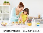 family  cooking and people... | Shutterstock . vector #1125341216