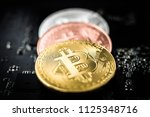 close up of bitcoins on... | Shutterstock . vector #1125348716