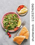 parsley salad or tabbouleh.... | Shutterstock . vector #1125374090