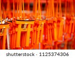 closeup of wooden torii or... | Shutterstock . vector #1125374306