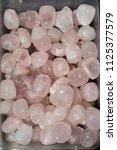tumbled rose quartz gem stone... | Shutterstock . vector #1125377579