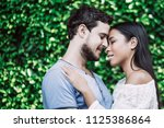 closeup of affectionate young... | Shutterstock . vector #1125386864
