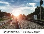 the child goes on rails  walks... | Shutterstock . vector #1125395504