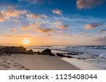 sunset at sunset beach on the... | Shutterstock . vector #1125408044
