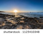 close up of waves rolling in... | Shutterstock . vector #1125410348