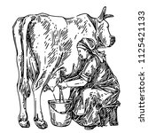 old woman milking a cow. sketch.... | Shutterstock .eps vector #1125421133