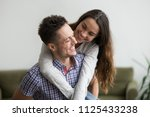 smiling wife embracing young... | Shutterstock . vector #1125433238