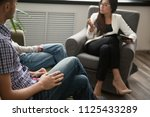 asian psychologist counseling... | Shutterstock . vector #1125433289