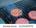 hamburger on grill grilling...   Shutterstock . vector #1125439370