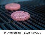 hamburger on grill grilling...   Shutterstock . vector #1125439379