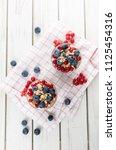 vanilla yoghurt parfait served...   Shutterstock . vector #1125454316