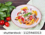 colorful pasta fusilli with... | Shutterstock . vector #1125460313