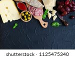 table full of mediterranean... | Shutterstock . vector #1125475340