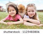 portrait of two cute little... | Shutterstock . vector #1125483806